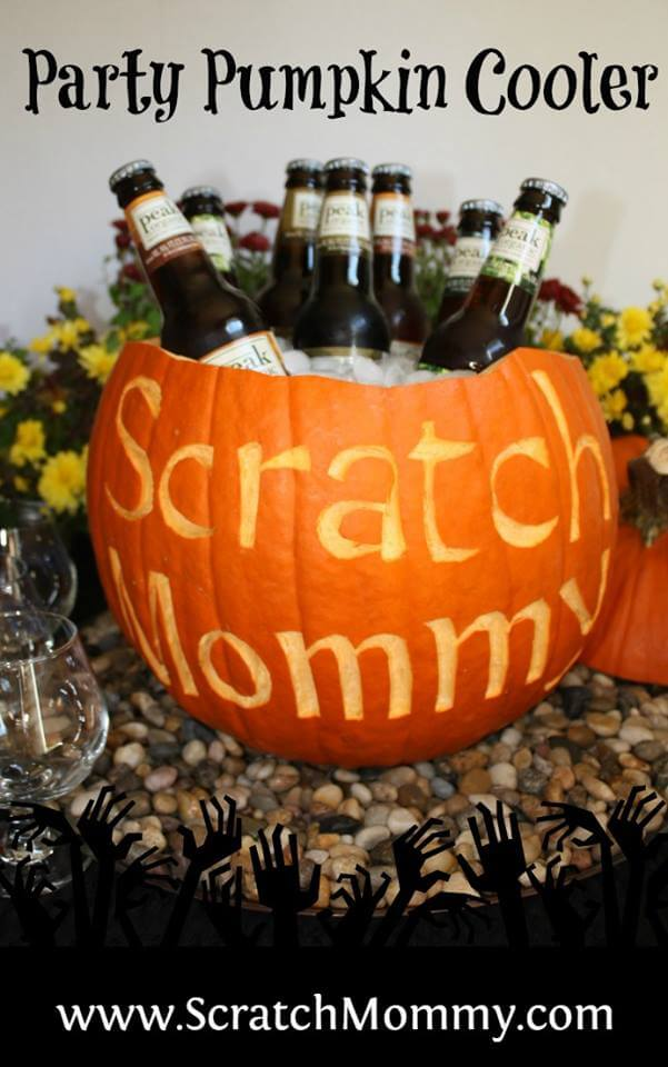 DIY Party Pumpkin Cooler. This DIY cooler would be perfect for a Halloween party. Substitute a watermelon for a fun summer cooler.