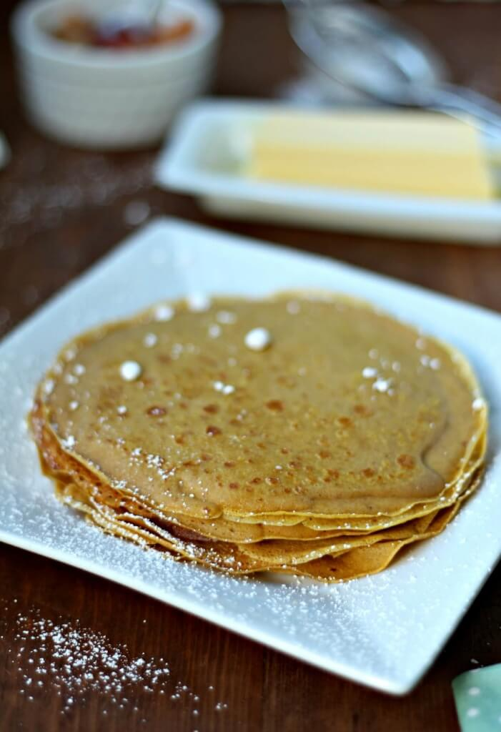 Fall. Crisp air, falling leaves, apples, pumpkins and crepes. Scratch Mommy shares a Gluten Free Pumpkin Crepes Recipe with Warm Apple Filling. Fall is here.