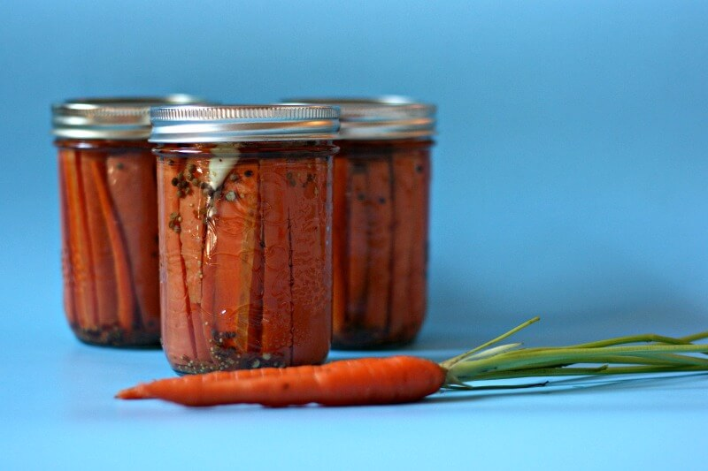 Scratch Mommy editor, Crystal Allen shares her Easy Spicy Pickled Carrots Canning Recipe. Easy and delicious they are crunchy, sweet, salty, sour & spicy.