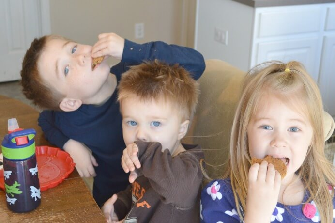 Happy kiddos enjoying gluten and dairy free peanut butter and oatmeal cookies!