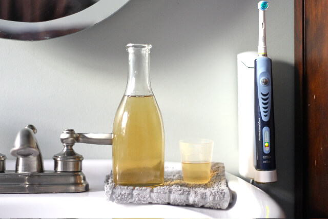 Missing the minty fresh feeling of your conventional toothpaste now that you've switched to a cleaner product? Try this DIY minty mouthwash to leave your mouth feeling refreshed and clean.