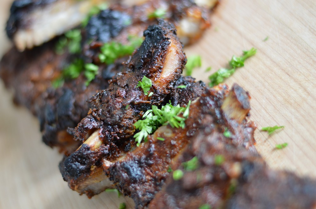 Ribs don't always have to be cooked on the grill. This recipe calls for a delicious homemade rib rub slathered on a rack of ribs and then cooked in the oven. The flavor is out of this world!