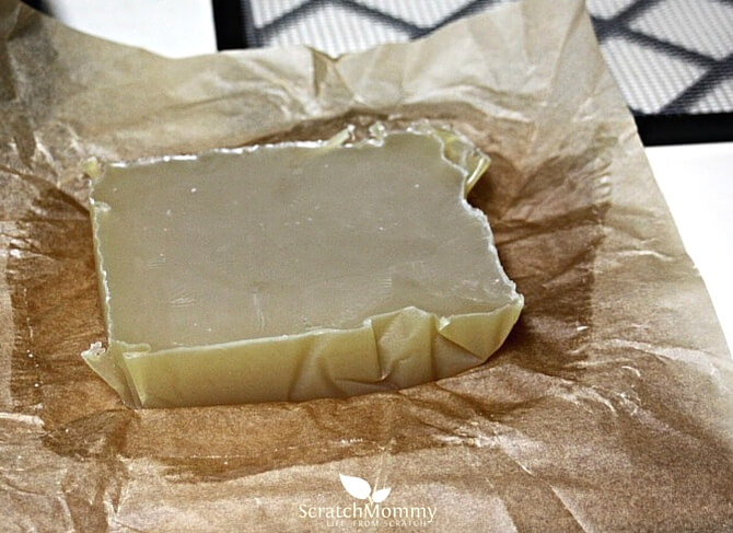 Solidified DIY glycerin soap from the mold. Learn how to make it!- Scratch Mommy